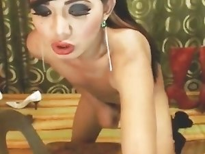 Tranny Strips and Masturbates her Dick